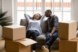 Couple relax while moving home