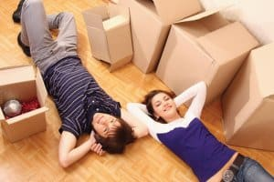 two people relaxing moving home